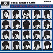 Copertina di Hard Day's Night. Primi piani dei Beatles.