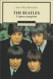 Copertina di The Beatles l'Opera completa. Collana Oscar Saggi Mondadori.